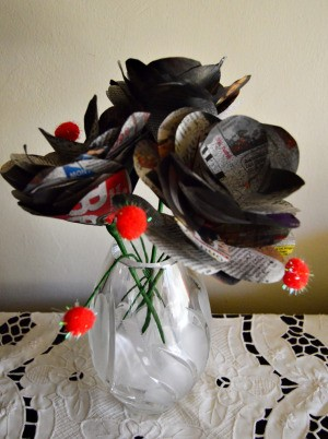 Bunch of Newspaper Roses - vase filled with roses and pom poms