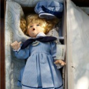 Information on a Wimbledon  Collection Betsy Doll - doll wearing a blue dress with saddle shoes