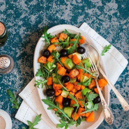 Sweet Potato Salad with avocado, olives and greens.
