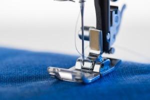 Closeup of sewing machine foot.
