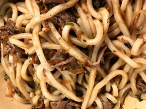 stir fry mixed with noodles