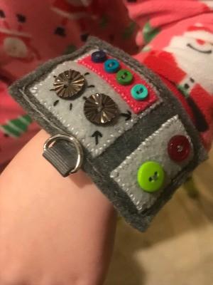 Felt Wrist Control Panel - control panel on child's wrist