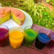 DIY Organic Food Colouring - containers of food colors next to a swirled cake