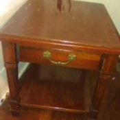 Value of a Mersman End Table - medium wood finish end table with drawer