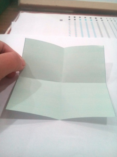 Folded Paper Star  - with colored side up fold in half horizontally and then vertically, crease and open up