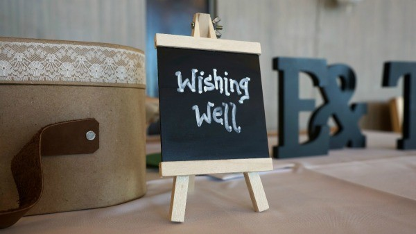 bridal shower wishing well with a small chalk board