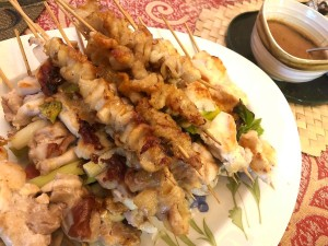 cooked skewered chicken