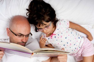 Father and daughter reading a book together