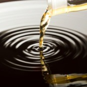 vinegar being poured into a pool of water.