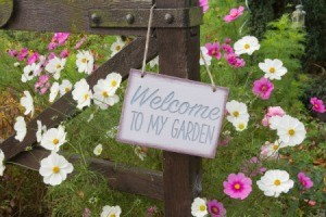 Welcome to my garden sign hanging on a gate.