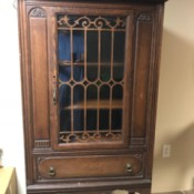 Identifying an Ornate Cabinet  - ornate perhaps antique cabinet with shelves, decorative glass door and lower drawer