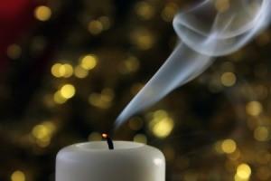 White votive candle recently extinguished.
