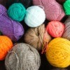 Balls of yarn in different colors and sizes.