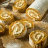 Cream Cheese Pumpkin Roll on cutting board.
