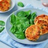 Salmon patties on a plate with spinach.