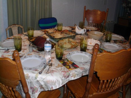 A Thanksgiving table set and ready for dinner.
