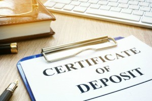Certificates of Deposit  on a desk.