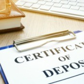 Certificates of Deposit  on a desk.