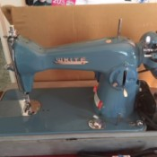Value of a Vintage White Sewing Machine - portable sewing machine in case