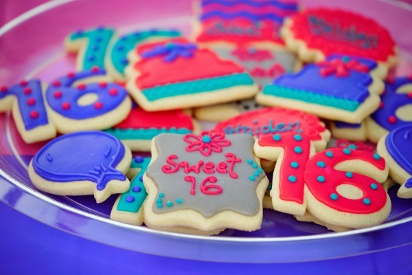 Orted Sweet 16 Frosted Cookies On A Plate
