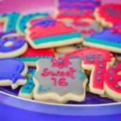 Assorted Sweet 16 frosted cookies on a plate
