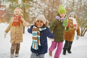 Kids happy playing in the snow.
