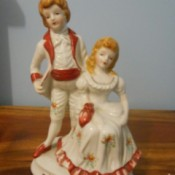 Identifying a Figurine - girl sitting with a boy standing behind her, both in period dress