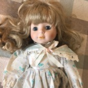 Identifying a Porcelain Doll  - doll in blue print dress