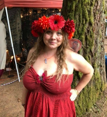 A red fairy costume with a flower crown and wings.