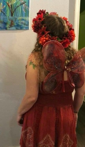 A red fairy costume with wings and a flower crown.