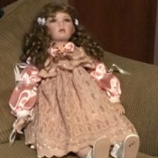 Value of a Porcelain Doll - doll wearing a pink lace and satin dress