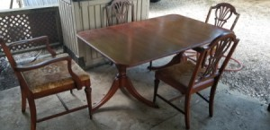 Value of a Dining Table and Chairs - table with two 3 legged pedestals and decorative back chairs