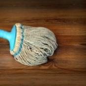 Rag mop on a wood floor.