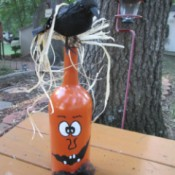 Jack-'o-Lantern Painted Wine Bottles - finished decoration outside