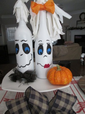 My Mr.& Mrs. Ghost Couple - bottles painted white and then decorated with faces and more to make ghosts