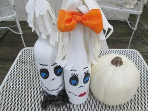 My Mr.& Mrs. Ghost Couple - couple on a patio table with a white pumpkin