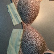 Bra with fabric patches attached to the underside of the bra cups.