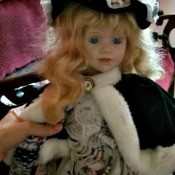 Identifying a Porcelain Doll - doll wearing a fur trimmed cape