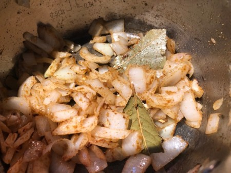 adding spices to onions