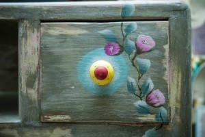 Drawer painted with flowers.