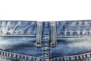 Close up of belt loops on a pair of jeans.