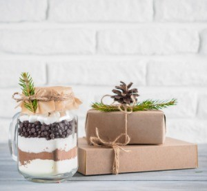 Gift mix in a jar next to boxed gifts.