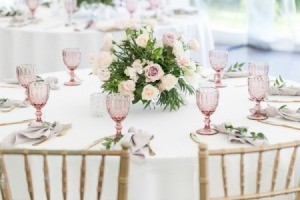 Wedding Reception table with a floral arrangement in the middle.