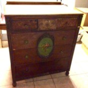 Value of an Old Dresser - old dresser with ornate floral medallion on center of two drawers