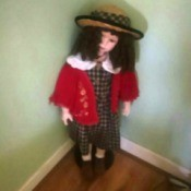 Value of a Limited Edition Knightsbridge Porcelain Doll - doll wearing a plaid dress and straw hat