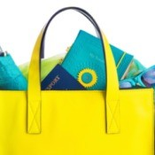 Yellow handbag with things coming out from the top.
