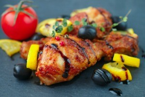 Balsamic Chicken with olives and lemon wedges.