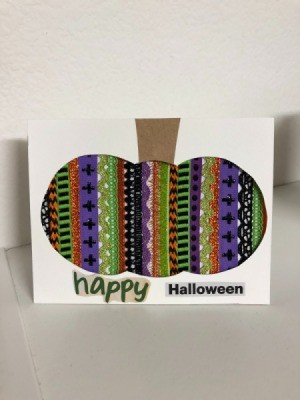 A finished Halloween card with a decorative pumpkin silhouette.