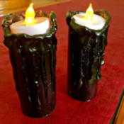 Spooky Candles - lit candles on red surface
