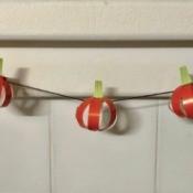 Pumpkin Garland - three paper pumpkins on yarn
